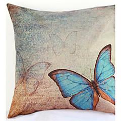 sininen perhonen tyynyliina sohva sisustustyynyn päällinen